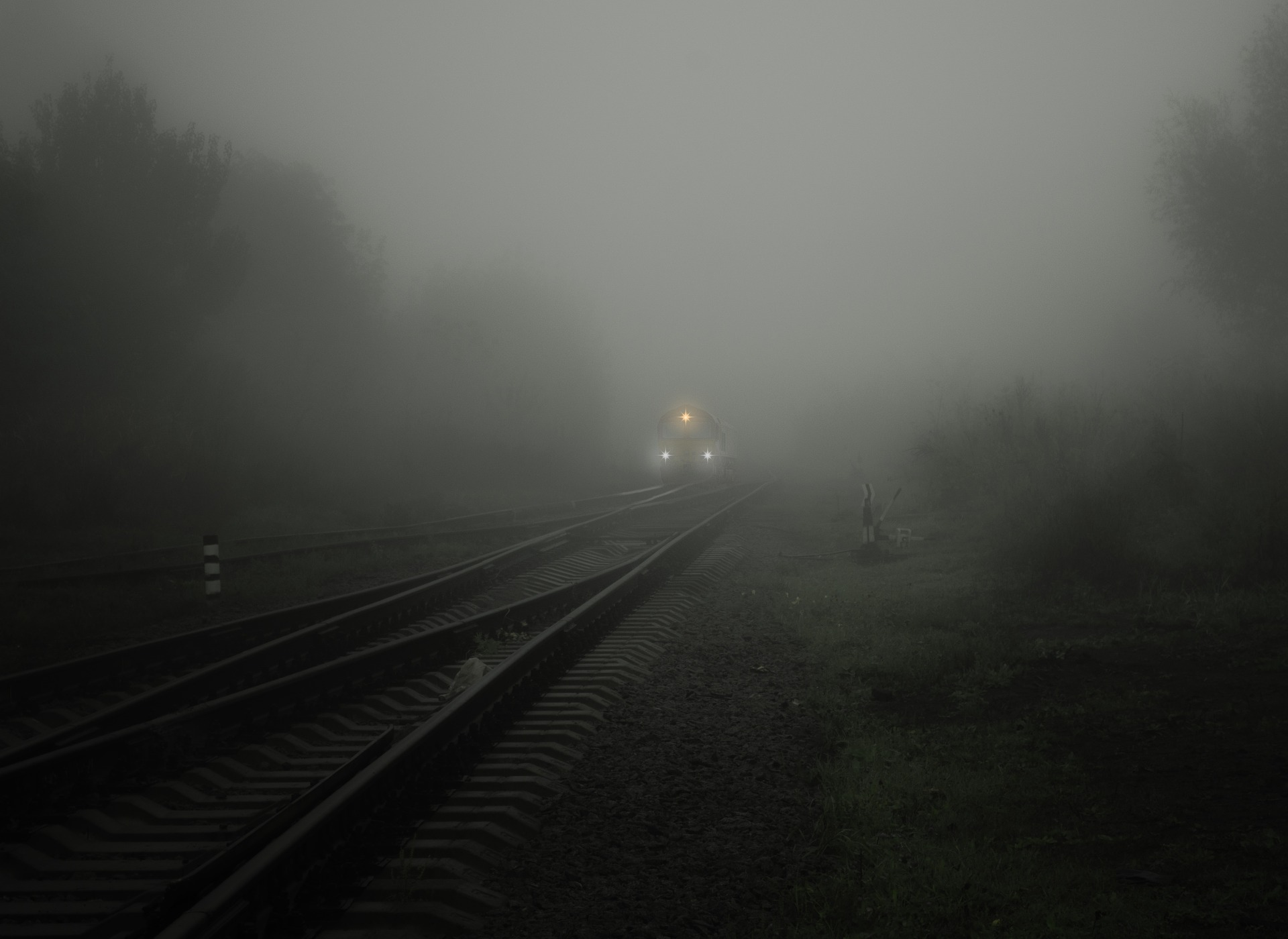 smog on tracks with train approaching